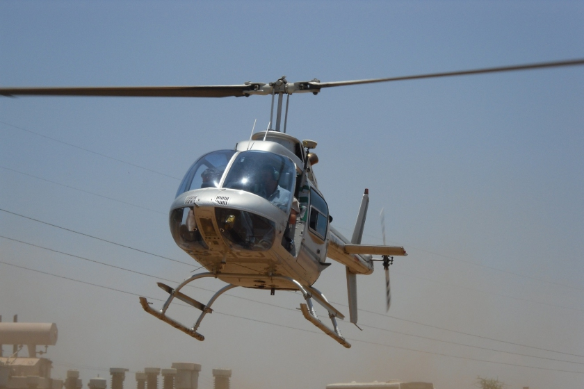 Image of a helicopter undertaking a LIDAR survey