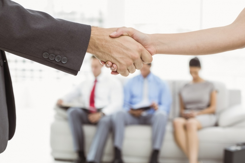 Image of a 2 people shaking hands