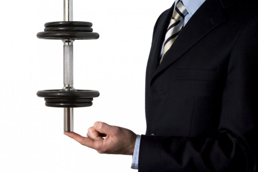 Image of a business man holding weights
