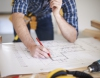 Architect studying planning map and drawings